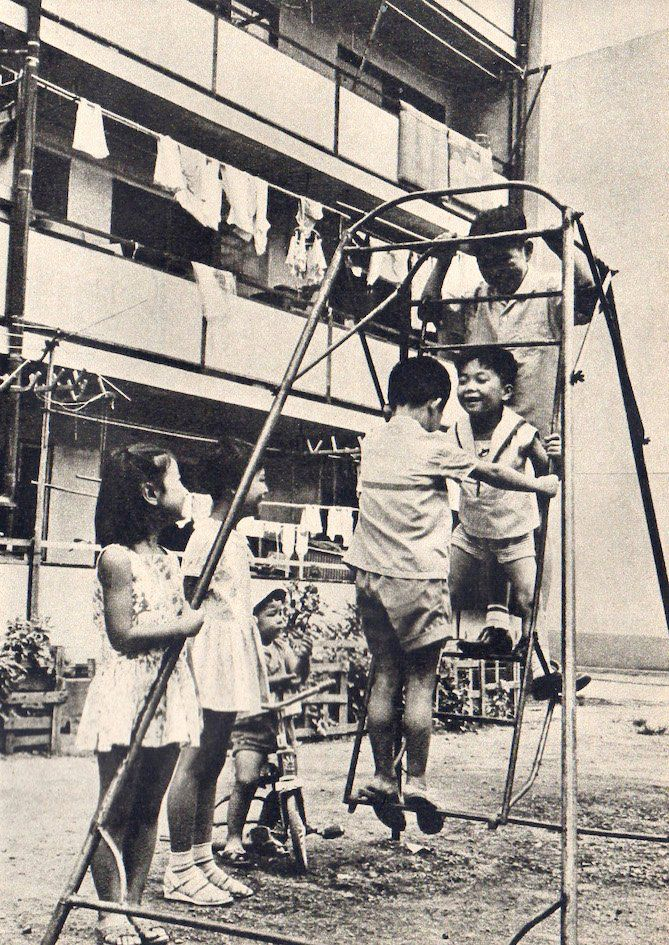 Children playing. Undated black and white vintage photo. Japan