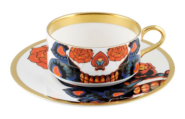 Inkhead Teacup & Saucer, a design inspired by tattoos and skulls. Hand Gilded in 22kt Gold. Made in Stoke-on-Trent, England. Fine Bone China