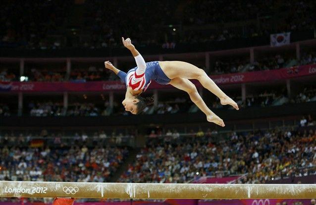 Gymnastics: Event Finals - Gymnastics Slideshows   Alexandra Raisman of the U.S. competes in the women's gymnastics balance beam final  (Photo: Mike Blake / Reuters) #NBCOlympics