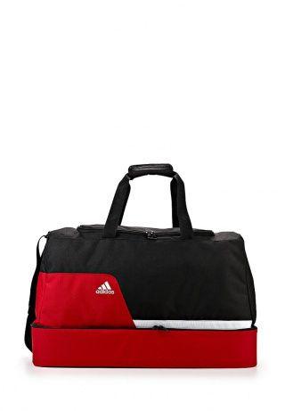 Удобная и вместительная спортивная сумка от Adidas Performance. Модель выполнена из плотного долговечного материала. Детали: застежка-молния, удобные ручки, плечевой ремень, два внутренних отделения и карман на молнии, контрастная цветовая гамма. http://j.mp/WNrrjk