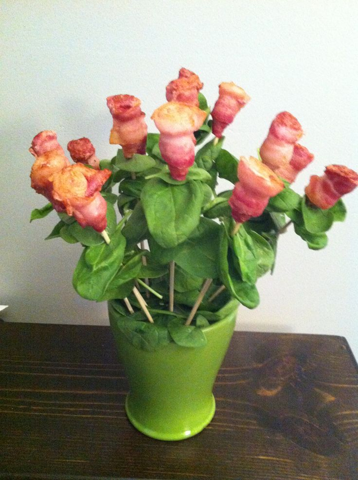 Bacon bouquet: roll up the bacon making the meat side level and the thickest part of the fatty side in the middle. Put a toothpick in the roll and place in a cupcake pan with the meat side down, baking at 375 for 35 minutes. Fill a pot or vase with styrofoam and cover with spinach leaves. When bacon is finished, rest on paper towel and place a few spinach leaves on skewers. Then top with the bacon rose and press the skewer into the styrofoam. Yummy :)