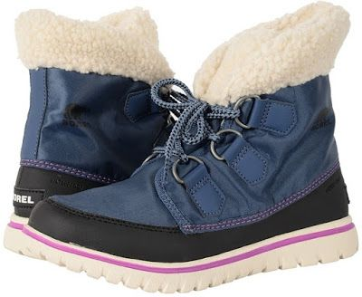 The Womens Sorel Cozy Carnival Ankle Boot features a seam sealed waterproof nylon upper, a warm fur lining that will keep your feet toasty and warm, vulcanized rubber sole unit, d-ring eyelet lace up closure with contrasting stitching accents and a Sherpa Pile snow cuff.