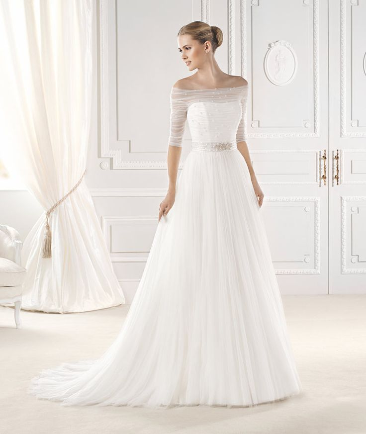 Soft and romantic, this wedding gown features a boat kneck A-line in soft tule.  Beaded belt inclueded.  #LaSposa #weddingown #Aline