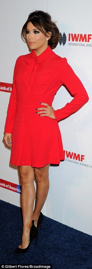 Red hot:She wore a bright red mini dress with black leather pumps...