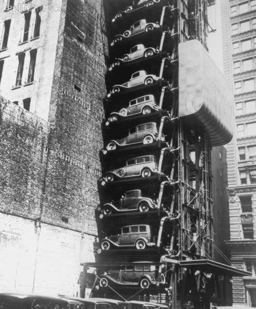"""This is a photo of an """"elevator garage"""" taken in Chicago, 1936. It was part of a building that no longer exists on 33 W. Monroe Street and held up to 48 cars. Workers simply drove into the elevator car, parked in their sky-high slots, then walked along the fire escape to their offices."""