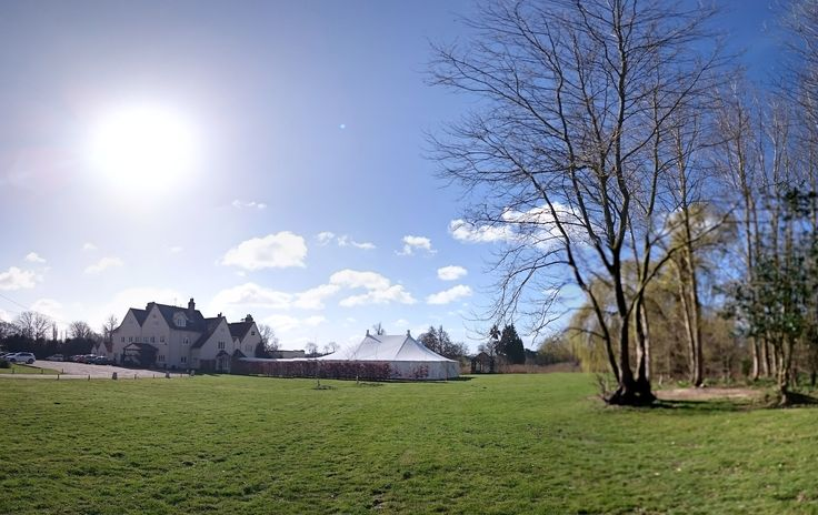 Panorama on a beautiful spring morning of The Hall and marquee  www.prested.co.uk/weddings