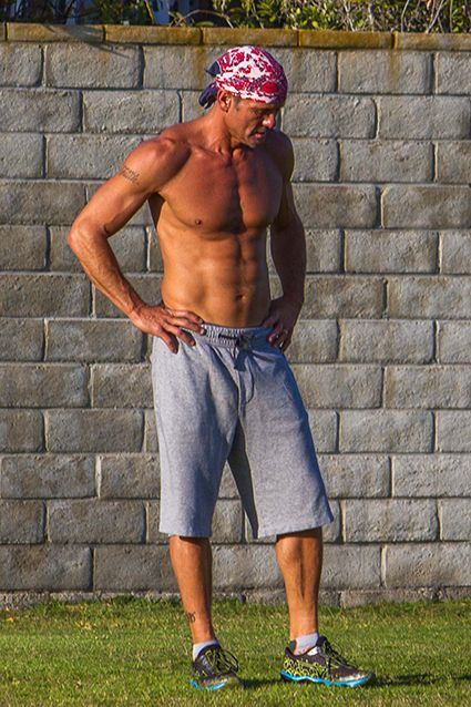 Tim McGraw Shows Off His Jaw-Dropping Abs with a Shirtless Workout