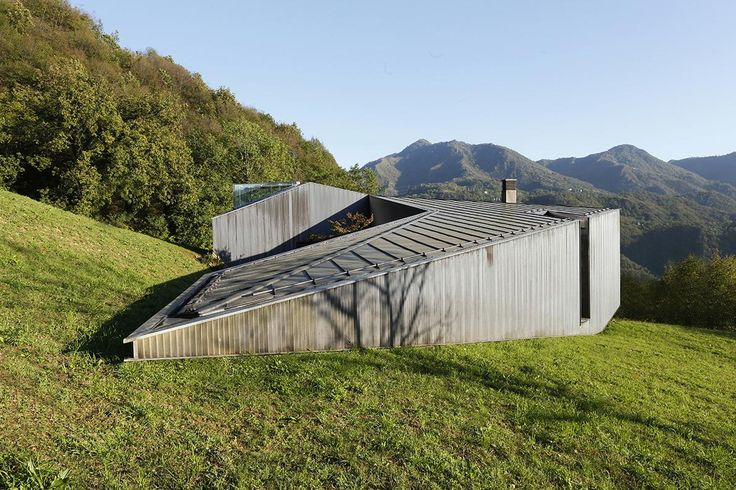 While the main entry to Alps Villa is on the lower side of the site's slope, Camilo Boticini Architects created a second entry on the 2nd floor that opens...