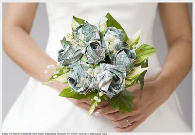 you can make an easy money bouquet by folding bills into fan shapes and tying in the middle, its a good way to make money a thoughtful present, of course here in Canada we'd be using 5$ bills so it'd be for someone special lol