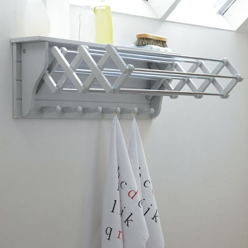 Extending Clothes Dryer from Cox & Cox The perfect solution for when space is tight and a great way of freeing up valuable floor space, this versatile dryer fixes to the wall and can be folded flush when not in use. The wooden arms extend to provide seven useful rails and there are a further six wooden hooks beneath for hanging tea towels and towels. It also has a handy top shelf ideal for storage. Made from birch plywood and painted in a dove grey colour