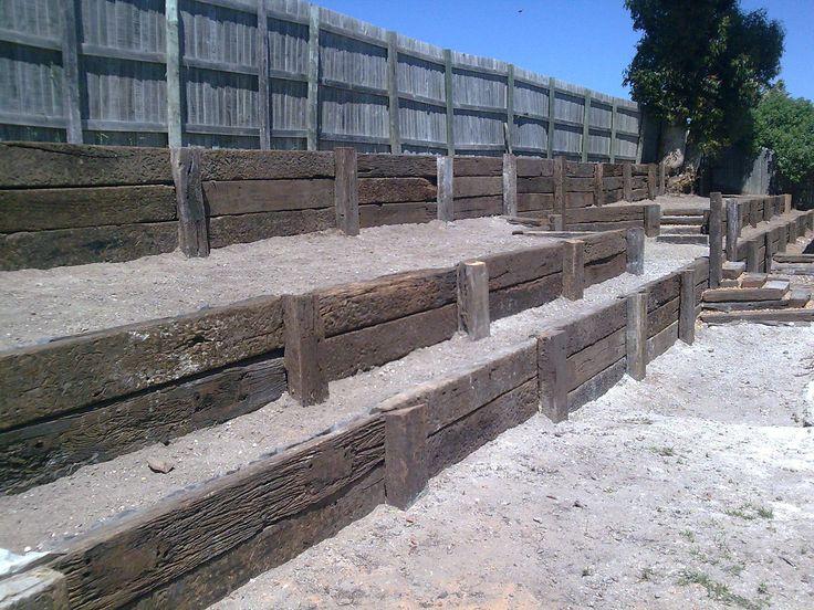 Hardwood retaining wall landscaping system