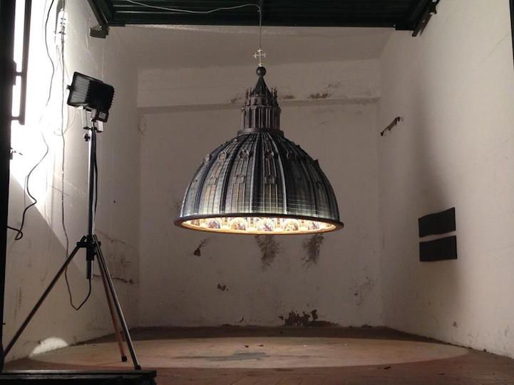 Spectacular hanging lamp illuminates a room with the beauty of st peters basilica