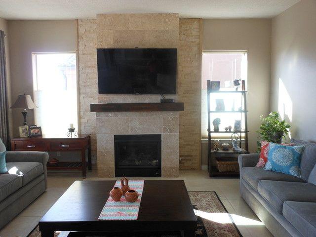 Living room fireplace tile design - Chiaro Honed Filled Travertine Floor Tile - 12 x 24 in.