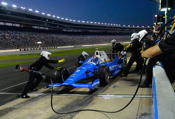 Scott Dixon, driver of the #9 NTT Data Chip Ganassi Racing Honda, makes a pit stop during the Verizon IndyCar Series Rainguard Water Sealers 600 at Texas Motor Speedway on June 10, 2017 in Fort Worth, Texas.
