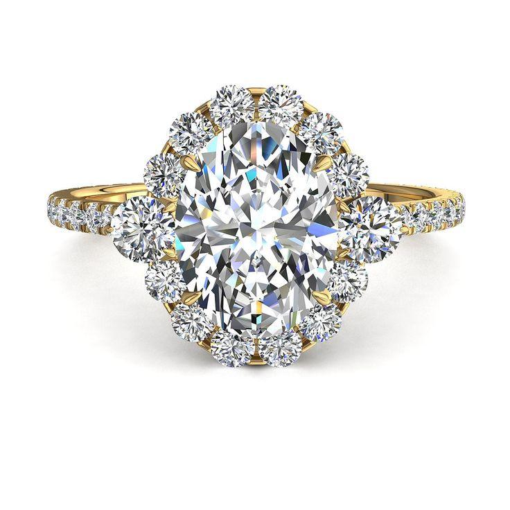 Bague de fiançailles solitaire diamant Alexandrina 1 carat or jaune  Somptueuse bague de fiançailles, Alexandrina est faite pour le plaisir du regard et le plaisir d'être portée. Sa pierre centrale qui est ovale est entre 0,30 carats et 1 carat selon votre choix. Autour du diamant central de cette bague, il y a 2 diamants qui la rehaussent et 12 diamants ronds. Cette belle bague de fiançailles diamant que nous fabriquons dans nos ateliers est montée sur de l'or blanc, jaune ou rose 18 carats…