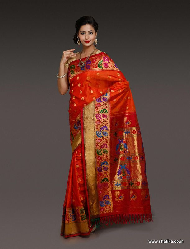 This Amoli Red Paithani Silk Saree with intrigue peacock design looks mesmerizing, giving a rich look right the moment you look at it. The luscious mono chrome paithani silk saree, with delicate muthuda work over brocaded pallu and border, marks itself as a creation of unique paithani silk drape. Traditional zari motif with an eye soothing red base is a must have.