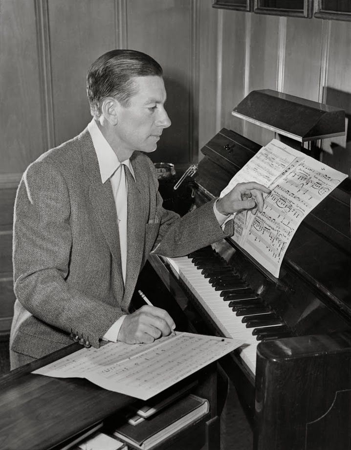 Hoagy Carmichael composing in the den of his Los Angeles home. Description from dlib.indiana.edu. I searched for this on bing.com/images