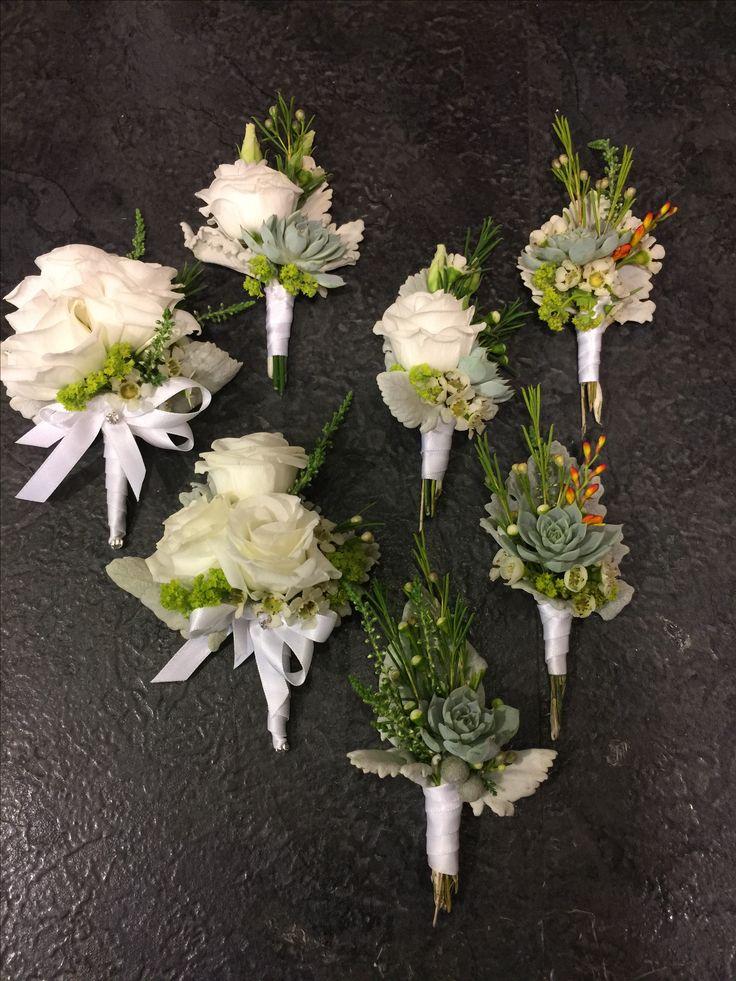 Boutonnieres: White lisianthus, White Wax Flower, White Heather, Silver Leaf, Succulents Bupleurum, neatly tied with satin ribbon.