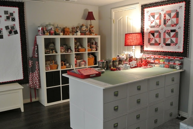 sewing room with cutting table, wall quilt in room's colors, design wall [quilt], storage, etc.