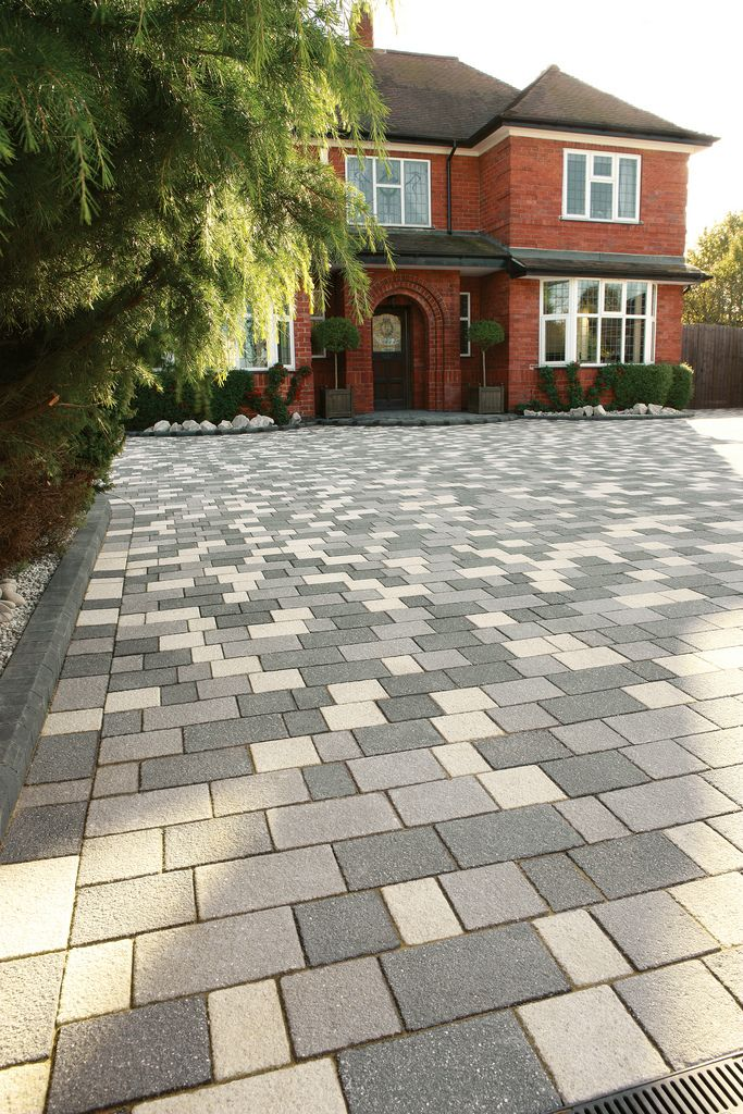 panache block paving used to enhance the front drive of a modern house for a contemporary