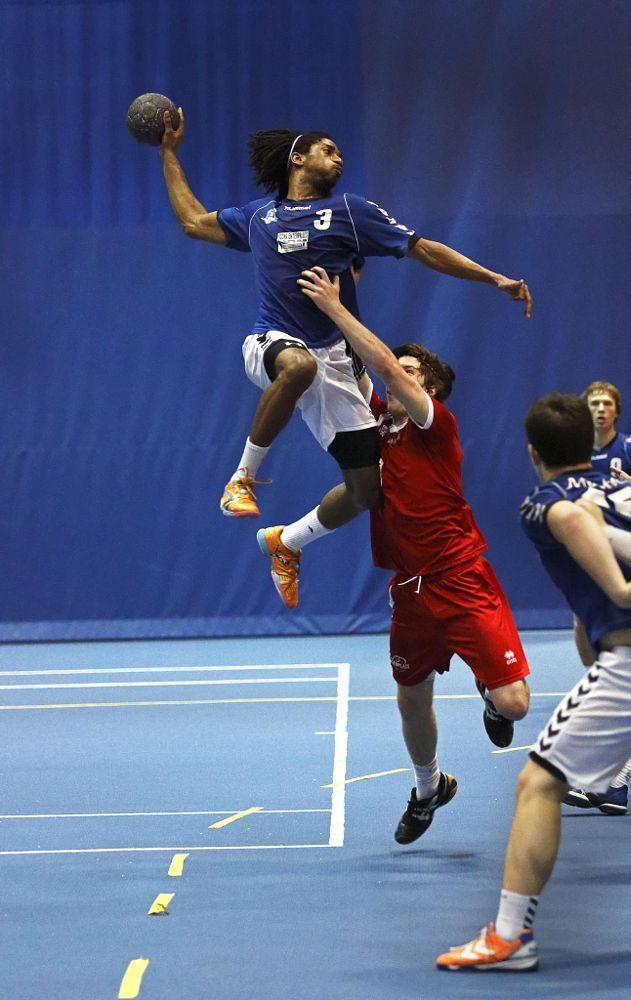 handball team man jump shot by Jamie Roach on 500px