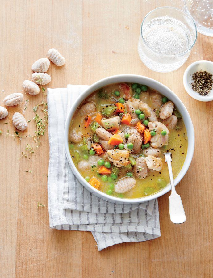 Chicken and Gnocchi Dumpling Soup   Homey and hearty chicken and dumplings has never been faster or easier, thanks to store-bought gnocchi. Browned bits from the seared chicken thighs create a rich base for the soup, while carrots and peas provide texture and fresh veggies to the soup. This kid-friendly soup is perfect for a weeknight dinner, and leftovers can be packed for lunch tomorrow.