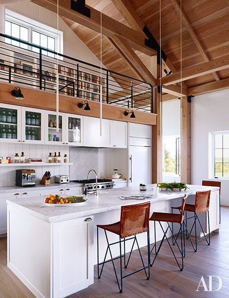 kitchen, design by Ashe + Leandro, pendant lights are by Davide Groppi, leather barstools are by Garza Marfa,