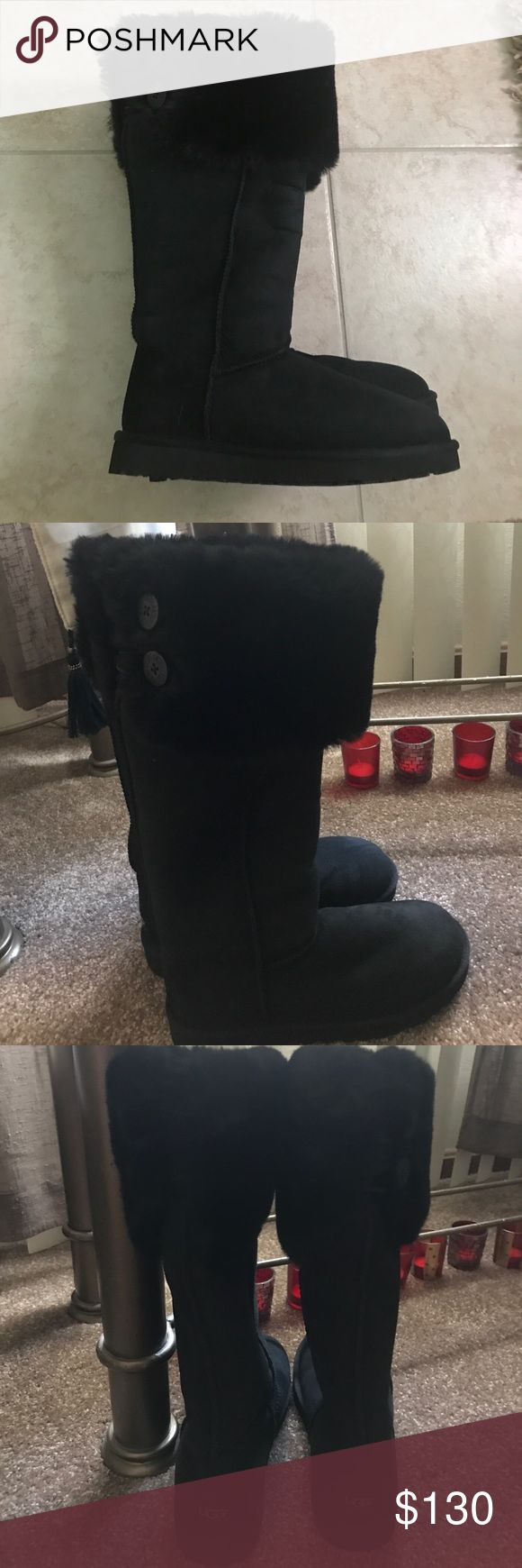 Retail 295.00 ugg Sherpa boots black w/fur sz 7 New retailed 295.00 ugg classic tall boots size 7, black. They have fur at the top and 2buttons. Brand new !!! UGG Shoes Winter & Rain Boots