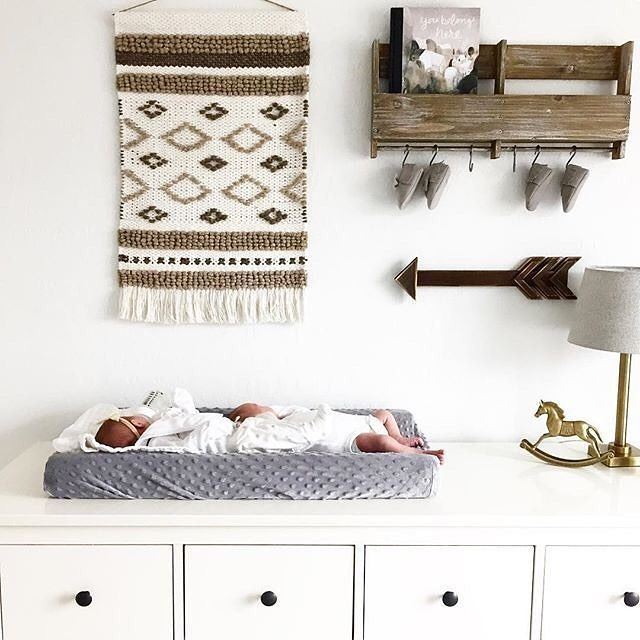 Woven wall hangings will continue to trend in the nursery in 2017 and this nursery is rocking it!