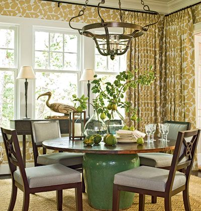 Soft colors and objects continue into the dining room, where a stylized teapot pattern engulfs the small space with softness, covering the walls and hanging as draperies. A Chinese pot as a table base and a hand-carved egret further emphasizes the room's relaxed character.