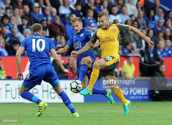News Photo : Jack Wilshere of Arsenal takes on Marc Albrighton...