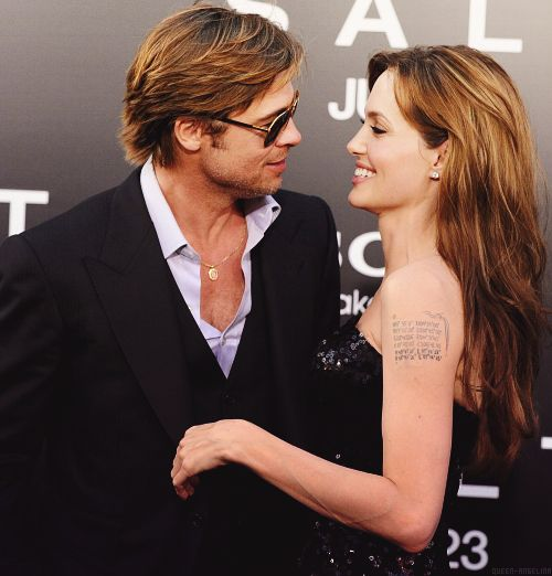 Angelina Jolie and Brad Pitt  Is that the arm that had the Billy Bob tatoo?!