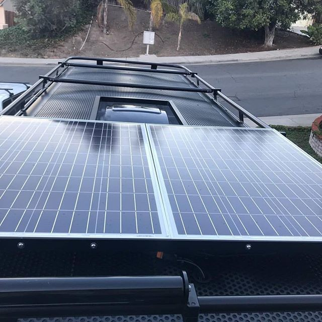 Aluminess Roof Rack With Solar Panels And A Place To Hang Out On Top Of Your Rig Van Roof Racks Roof Rack Solar Panels Roof