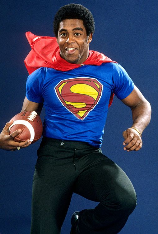 Pitt running back and Heisman Trophy winner Tony Dorsett poses as Superman during a photo shoot for SI on Dec. 1, 1976. The second overall pick of the 1977 NFL draft and four-time Pro Bowler with the Dallas Cowboys, who was inducted into both the College Football and Pro Football Hall of Fame in '94, turned 60 today. (Manny Millan/SI)