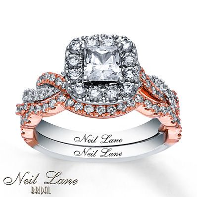 From Hollywood jewelry designer Neil Lane, this bridal set is designed to make her feel like a star. A stunning princess-cut diamond at the center is framed in round diamonds. Additional round diamonds are set into twists of 14K rose and white gold along the band. The matching wedding band is contoured to perfectly fit alongside the engagement ring. The set from Neil Lane Bridal® has a total diamond weight of 1 7/8 carats and features Neil Lane's signature inside both bands. Diamond ...