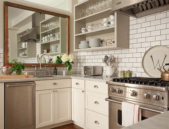 Would You Hang an Oversized Mirror in Your Kitchen? ...it would make your feel less confined when at the sink i think