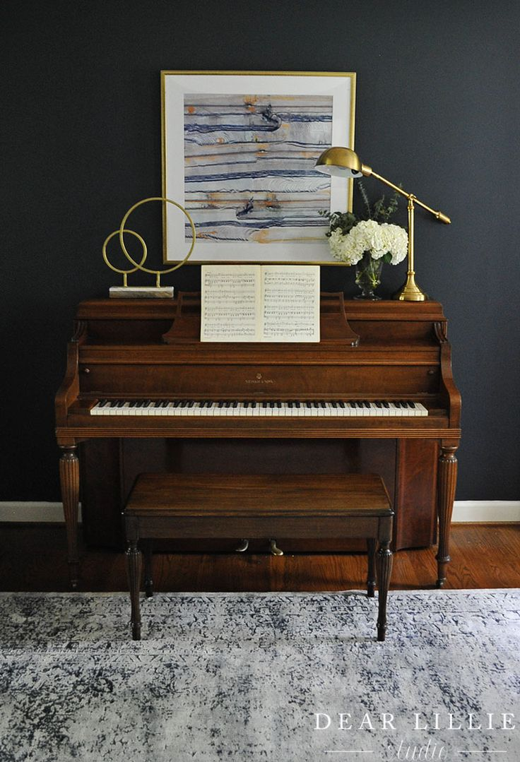 Adding some modern touches like this gold scupture and reading lamp from HomeGoods helps too balance out the traditional feel of the piano and give it an updated look. (sponsored pin)