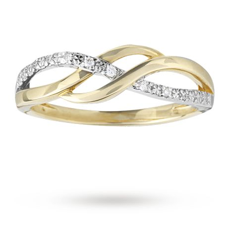 Diamond cross over ring set in 9 carat yellow gold