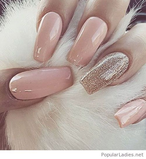 Long nude gel nails with some gold glitter