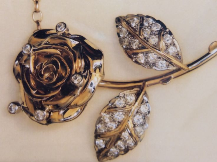 Rose sculptured diamond pendant in yellow and white gold