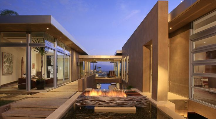 The water winds its way from the entryway into an ornamental pool, before flowing into a 75-foot-long lap pool and infinity pool.  (McClean Design)