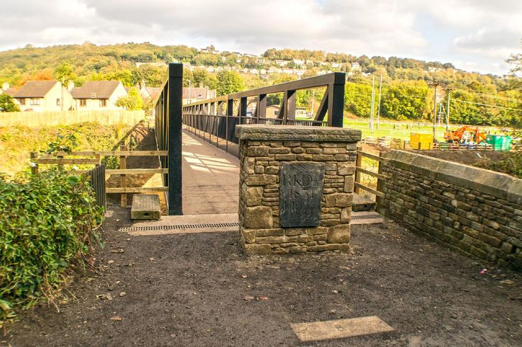 The bridge named after the former owner of the toll house Mr Graham Wilson is the replacement for the former Copley Toll Bridge that stood from 1831 until damaged beyond repair by the Calder Valley Boxing Day Floods in 2015. Copley Village can be seen beyond the bridge and River Calder. More of my pictures and information can be seen at, www.colingreenphotography.blogspot.co.uk