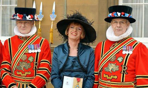 Grayson Perry picking up his CBE