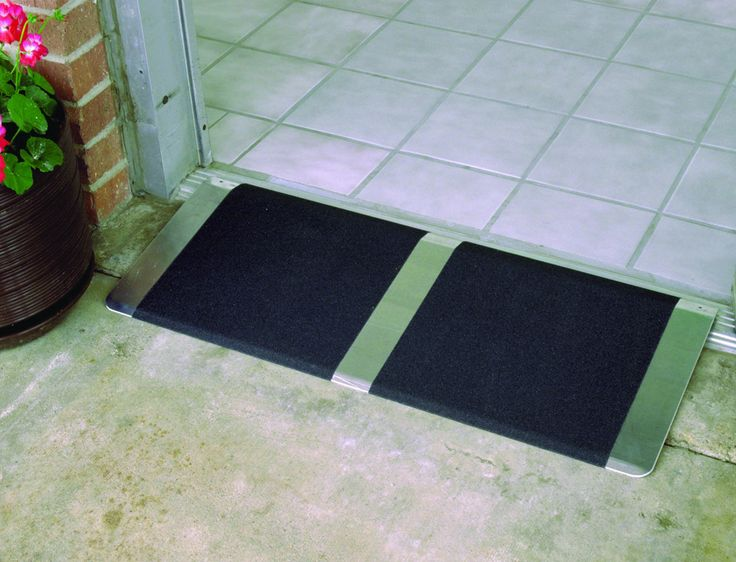 Grooved aluminum threshold ramp is adjustable from 1 to 2