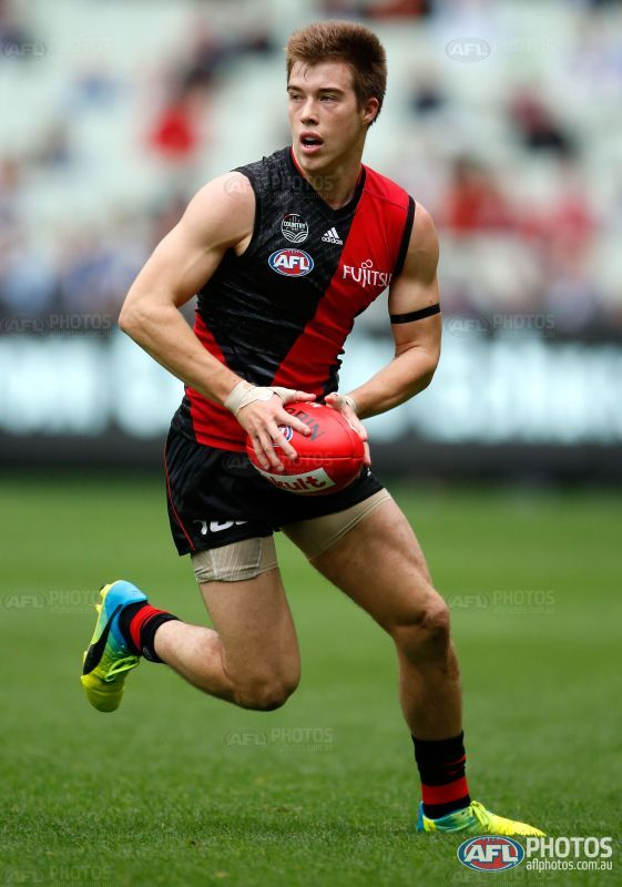 Zach Merrett of the Bombers in action during the 2016 AFL Round 04 match between the Essendon Bombers and the Geelong Cats at the Melbourne Cricket Ground, Melbourne on April 16, 2016.