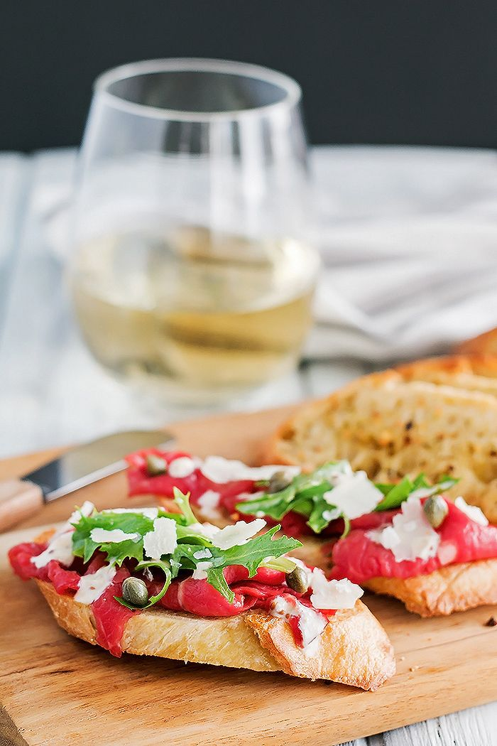 Thinly sliced beef carpaccio, just the way we like it, on top of a toasted crostini, drizzled in a mustard horseradish sauce, and finished with zippy capers.