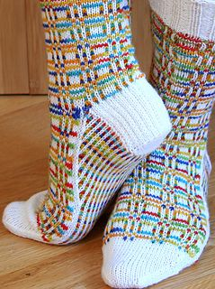 Ravelry: Sox Squared pattern by Camille Chang. I have some yarn that would be awesome for this!