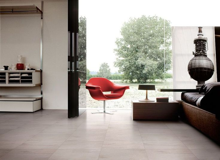 A red seat provides colorful contrast to elegant ceramic flooring from Tierra Sol Ceramic Tile. #luxePNW