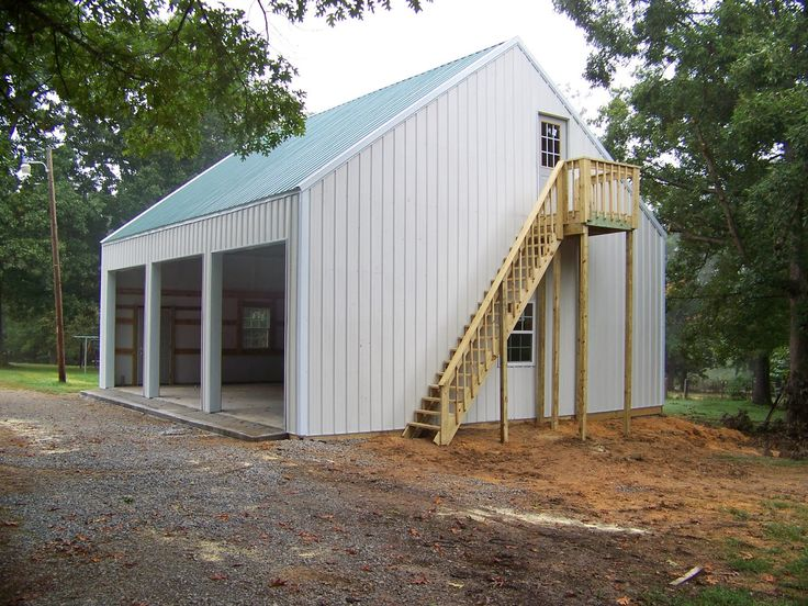Steel building with loft this is a 3 car 30x36 garage for Barns with apartments above