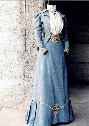 1890 blue cotton walking suit with details of Venetian point lace and glass beads.